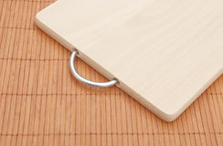 Chopping board on bamboo placemat Stock Images