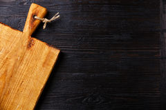 Chopping board on Burned wooden background Stock Photo