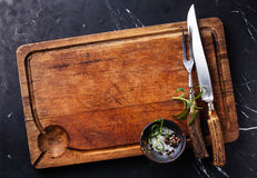 Chopping board with carving set Royalty Free Stock Images