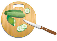Chopping board with cucumber Royalty Free Stock Images