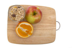 Chopping board and fruit Stock Image