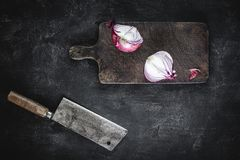 Chopping Board and Halved Red Onion with Meat Cleaver. Rustic Chopping Board and Halved Red Onion with Old Meat Cleaver stock photos