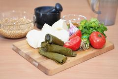 Chopping board with ingredients for salad preparation Stock Photography