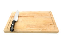 Chopping board and knife. Wooden chopping board and knife isolated on a white background royalty free stock photos