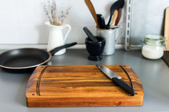 Chopping Board and Knife on Grey Table-top Kitchen Stock Photography