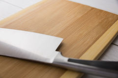 Chopping board with large knife Stock Images