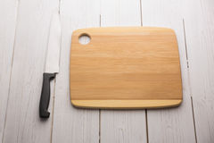 Chopping board with large knife Stock Photo