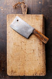 Chopping board and Meat cleaver Royalty Free Stock Images