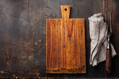 Chopping board and meat fork Stock Images