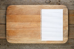 Chopping board and paper for recipe Royalty Free Stock Images
