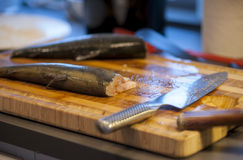 Chopping board with rainbow trout. Chopping board with two cleaned rainbow trout ready for cooking Royalty Free Stock Photos