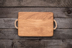Chopping board on rustic table Royalty Free Stock Photography