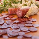 Chopping board of salami Stock Photo