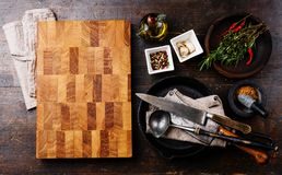Chopping board, seasoning and meat cleaver stock photo