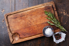 Chopping board, seasonings and rosemary Stock Photography