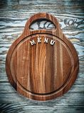 Chopping board text on wooden surface Royalty Free Stock Images