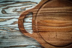 Chopping board on wooden surface top view Royalty Free Stock Photography
