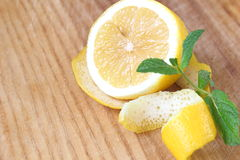 On the chopping board. Yellow lemon with fresh sprig of mint. Yellow lemon with fresh sprig of mint Royalty Free Stock Photo