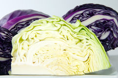 Chopping of cabbage closeup. Chopping of cabbage closeup, green and violet stock images