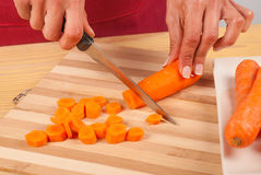 Chopping carrots Royalty Free Stock Image