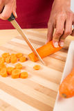 Chopping carrots Stock Images