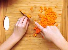 Chopping carrots Royalty Free Stock Photo