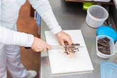 Chopping chocolate Stock Image