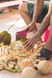 Chopping coconut by knife. Chopping coconut by big knife royalty free stock photography