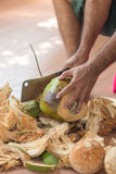 Chopping coconut by knife. Chopping coconut by big knife royalty free stock photos