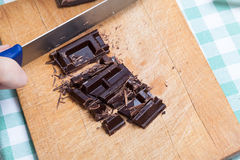 Chopping cubes of chocolate (top view). Chopping cubes of chocolate - top view royalty free stock photos