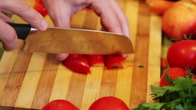 Chopping the end of a red bell pepper stock video footage