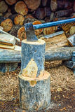 Chopping firewood. Old axe and pile of  firewood Stock Photos