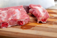 Chopping fresh pork ribs Royalty Free Stock Images