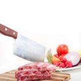 Chopping fresh pork ribs and vegetables Stock Photo