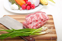 Chopping fresh pork ribs and vegetables Stock Photography