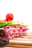 Chopping fresh pork ribs and vegetables Royalty Free Stock Photography