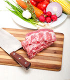 Chopping fresh pork ribs and vegetables Stock Photos