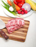 Chopping fresh pork ribs and vegetables Royalty Free Stock Image