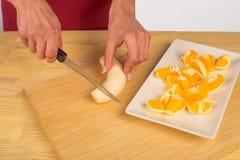 Chopping fruit Royalty Free Stock Photos