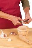 Chopping garlic Stock Photos