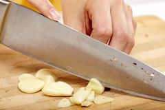 Chopping the garlic Royalty Free Stock Photo