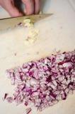 Chopping garlic Stock Images