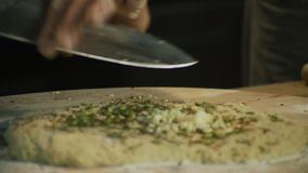 Making sauce with pasta. Chopping garlic with knife .Making sauce with pasta stock video footage
