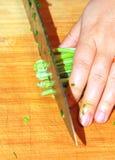Chopping Garlic Sprouts Royalty Free Stock Photos