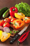 Chopping healthy vegetables pepper tomato salad onion chilli on Stock Photo