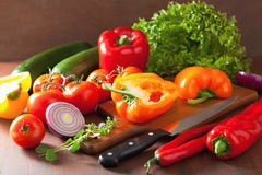 Chopping healthy vegetables pepper tomato salad onion chilli on Royalty Free Stock Photo