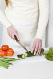 Chopping Ingredients to a Salad Stock Image