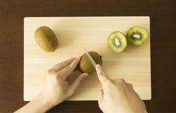 Chopping Kiwi Stock Image