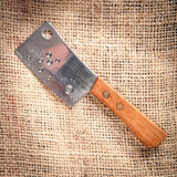 Chopping-knife. On a fabric coffee bag background Stock Photography