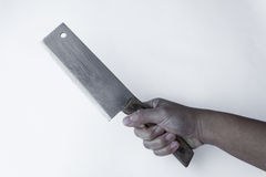 Chopping knife in hand. On grey background Stock Image